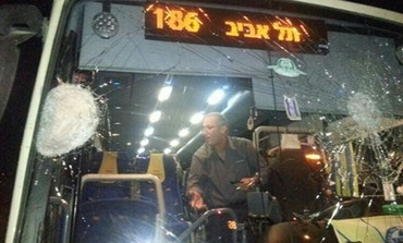 Bus damaged by stone throwing