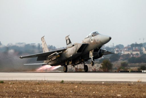 An Israeli air force F15-E fighter jet takes off for a mission over the Gaza Strip, from the Tel Nof air base in central Israel November 19, 2012. Israel bombed dozens of targets in Gaza on Monday and said that while it was prepared to step up its offensive by sending in troops, it preferred a diplomatic solution that would end Palestinian rocket fire from the enclave. REUTERS/Baz Ratner (ISRAEL - Tags: CIVIL UNREST POLITICS MILITARY)
